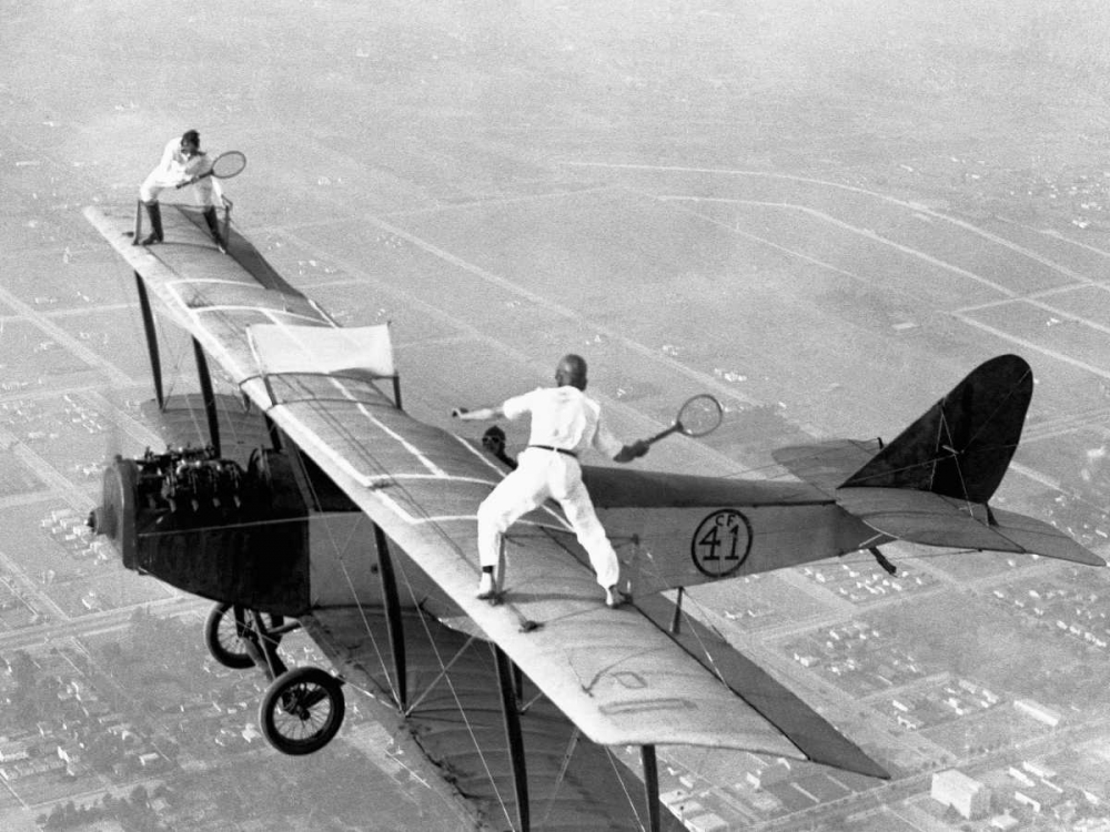 Daredevils Playing Tennis on a Biplane 1925 Anonymous 43669