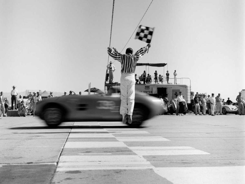 Man jumping waving checkered flag H. Armstrong Roberts 118030
