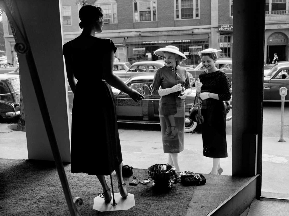 Women looking at window display Anonymous 149029