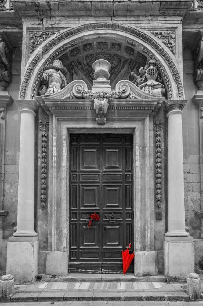 Bunch of roses with umbrella on door of a building in Mdina, Malta Frank, Assaf 103939