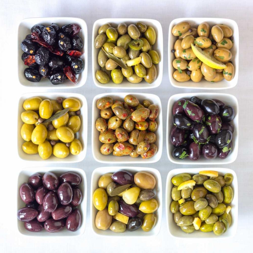 Varieties of Olives in bowls on white background Frank, Assaf 104158