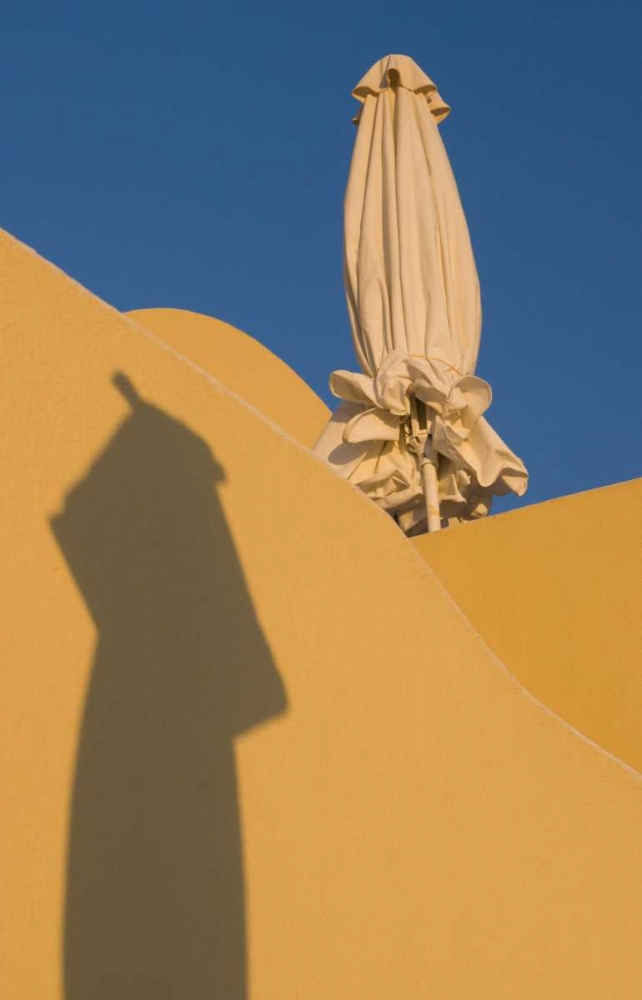 Greece, Santorini Sun umbrella against a wall Young, Bill 136419